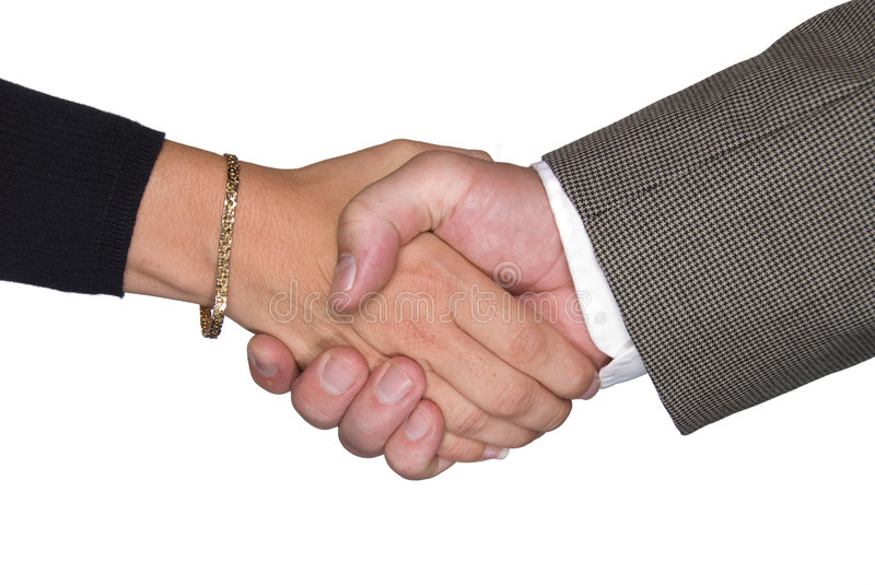 Male and female shaking hands stock photo