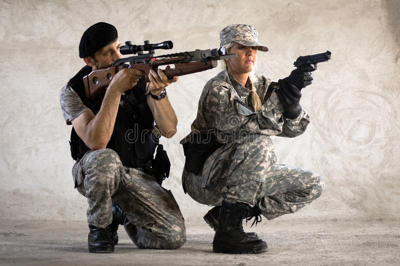Male and female military persons stock images