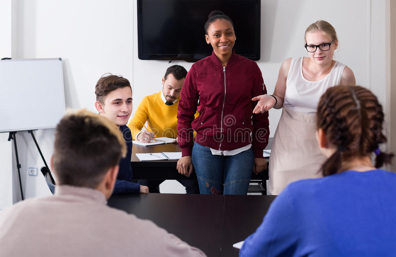 Male and female students having conversation at recess stock photos