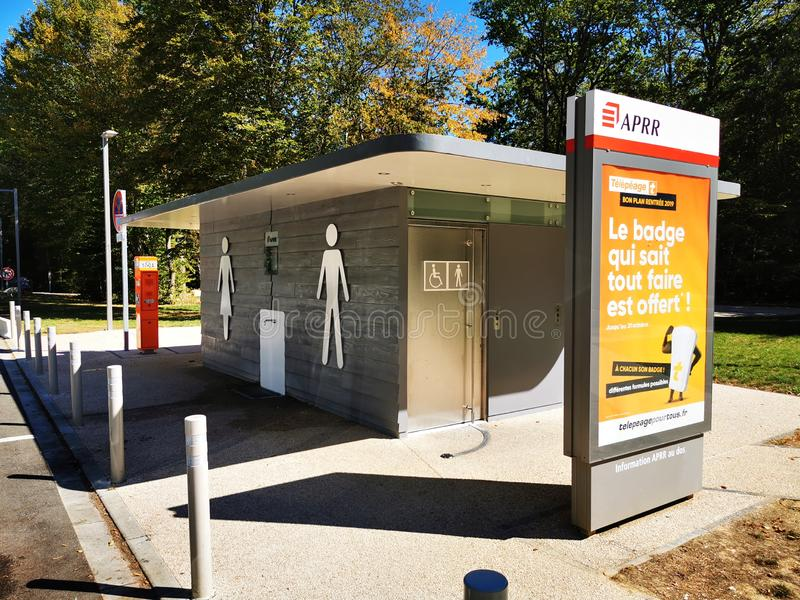 Toilet at rest stop. Male and female toilets at a rest stop on French motorway autoroute, Aire De Corgoloin stock image