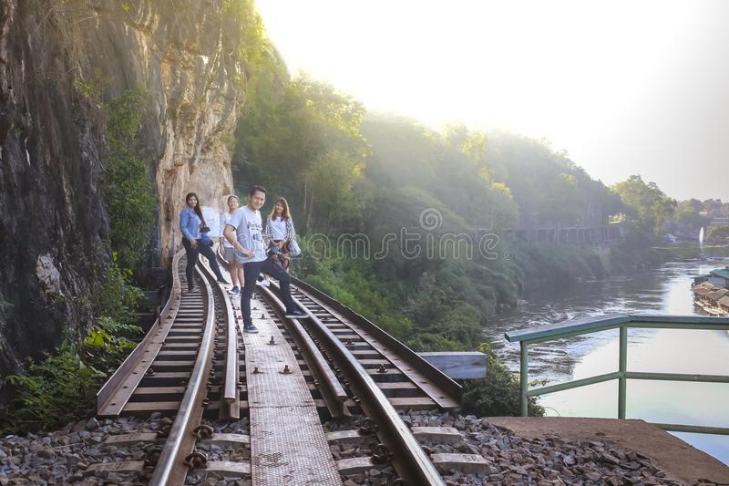 Male and female tourists visit the railway of death in the history of World War 2. royalty free stock photo