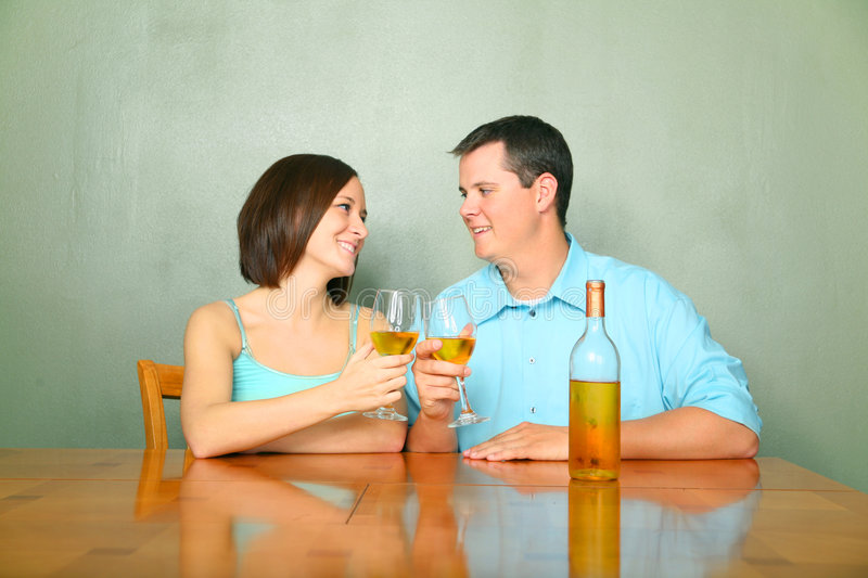 Male And Female Young Caucasian Drink Wine royalty free stock image