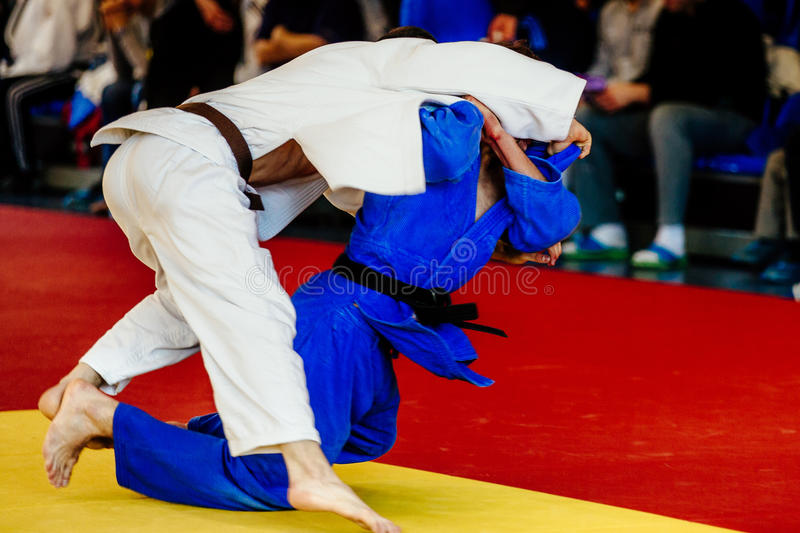 Male fighter judoka. Shoulder throw judo competition royalty free stock photography