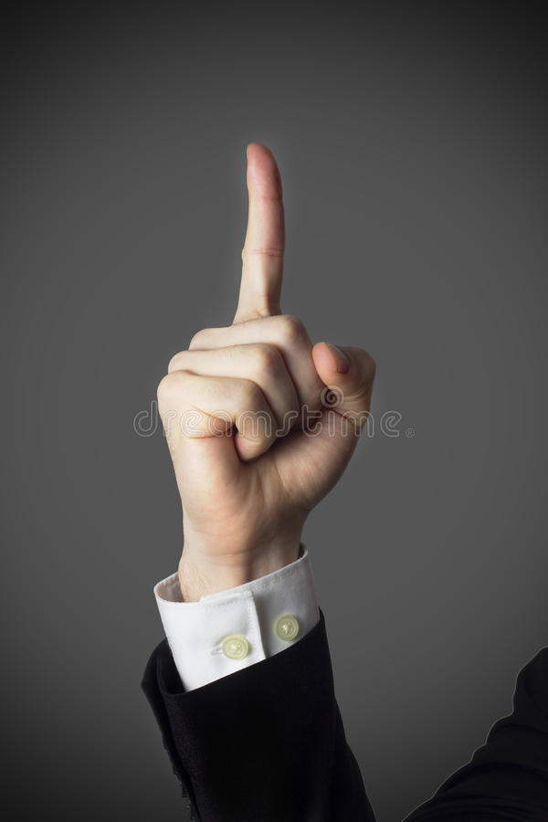 Male finger pointing up. Warning threat stock photo