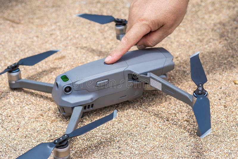 Male finger presses the launch button of the drone for flight, with which you can take photos and video filming, close royalty free stock photography