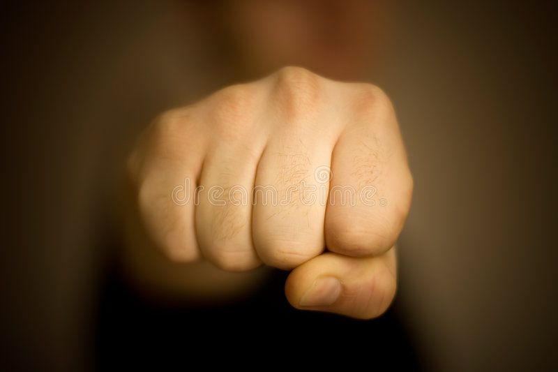 Male fist front view. Low DOF royalty free stock images