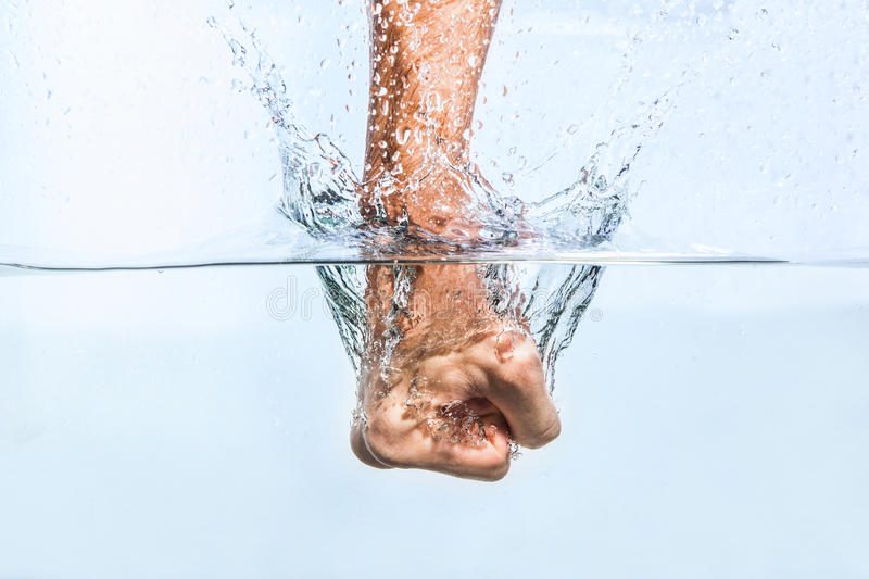 Male fist through the water royalty free stock image