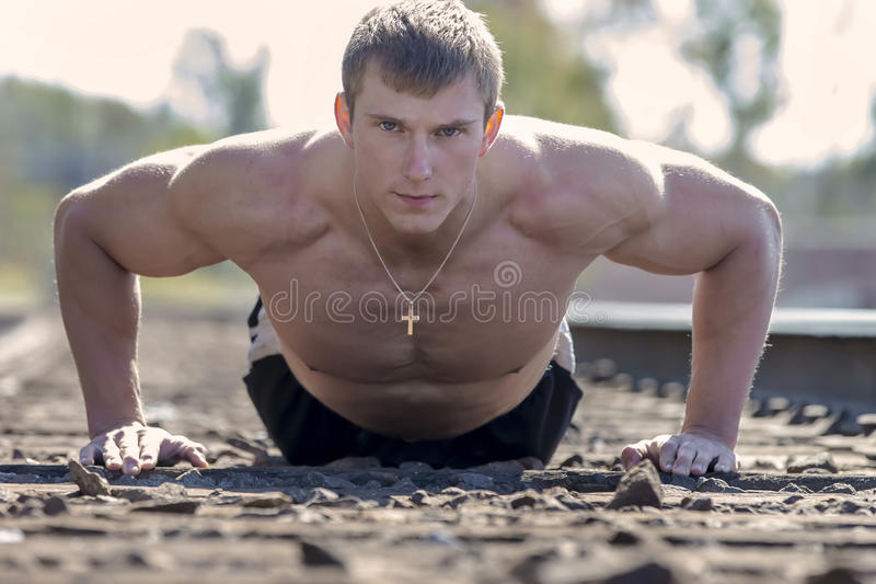 Male Fitness Athlete. A male athlete preparing for a fitness competition stock photography