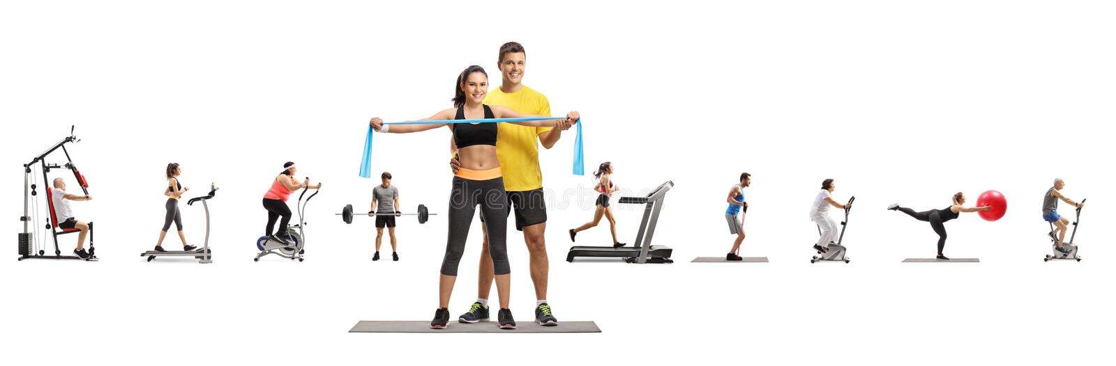 Male fitness instructor with a young female and people exercising stock photos