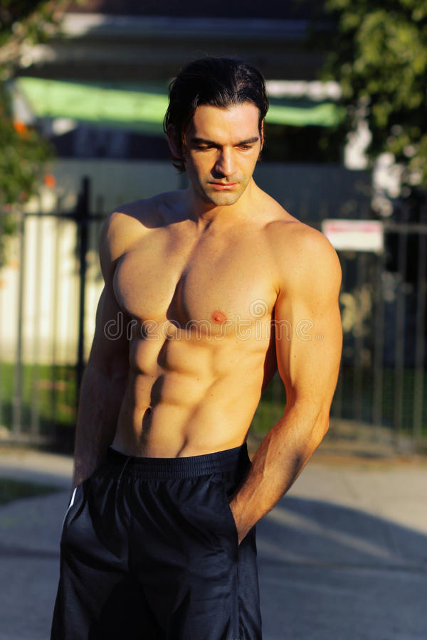 Male fitness model outdoors royalty free stock photos