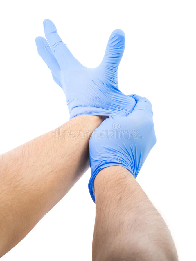 Male Fitting Latex Gloves. Male Stretching And Fitting Latex Glove stock photo