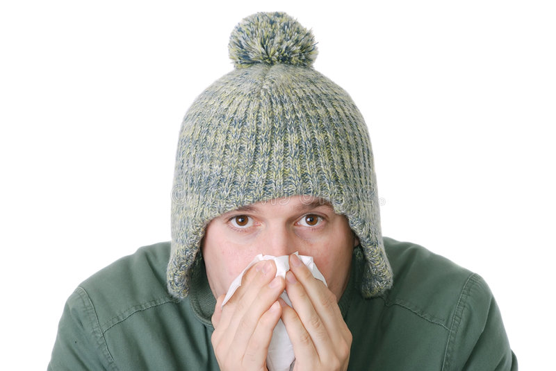 Male flu. Young male with a flu blowing his nose royalty free stock image