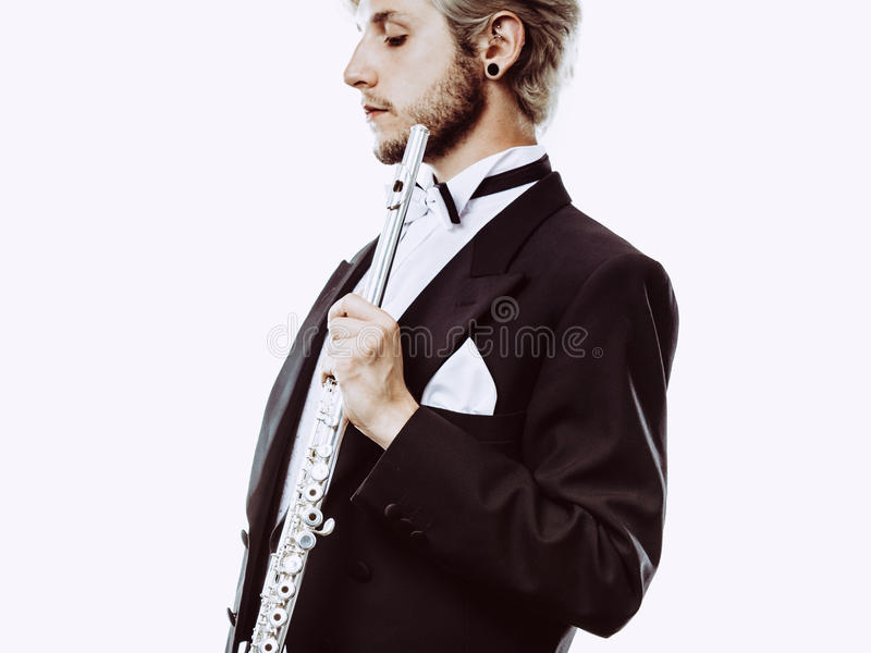 Download Male Flutist Wearing Tailcoat Holds Flute Stock Photo - Image: 83715220