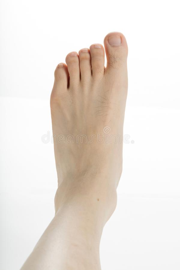 Male foot. With white background close up shot stock images