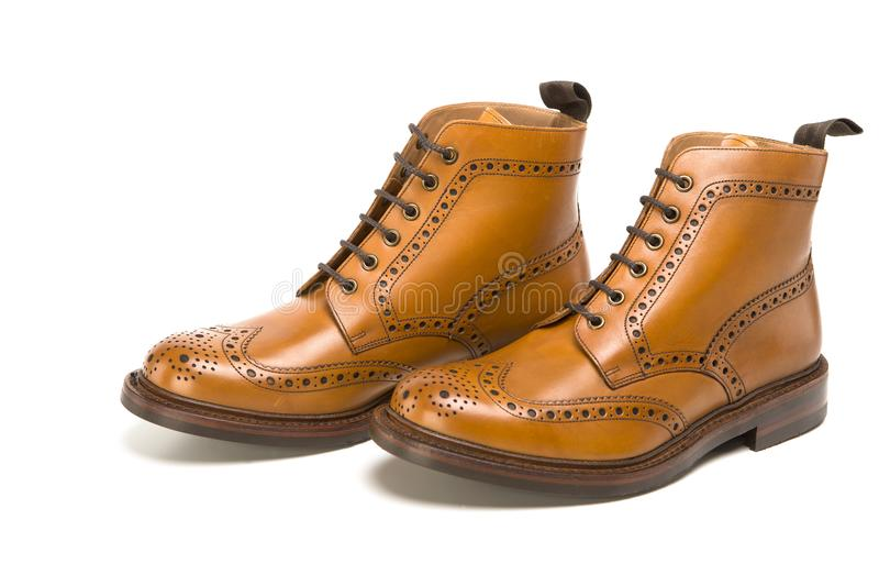 Male Footwear Ideas. Pair of Premium Tanned Brogue Derby Boots. Made of Calf Leather with Rubber Sole. Isolated Over Pure White Background. Horizontal Shot royalty free stock photos
