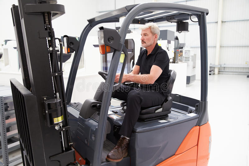 Male Fork Lift Truck Driver Working In Factory royalty free stock photo