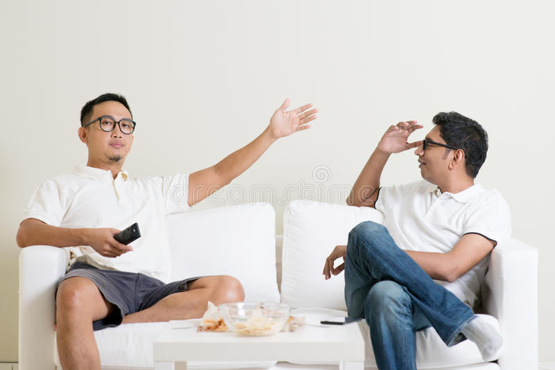 Male friends arguing stock photos