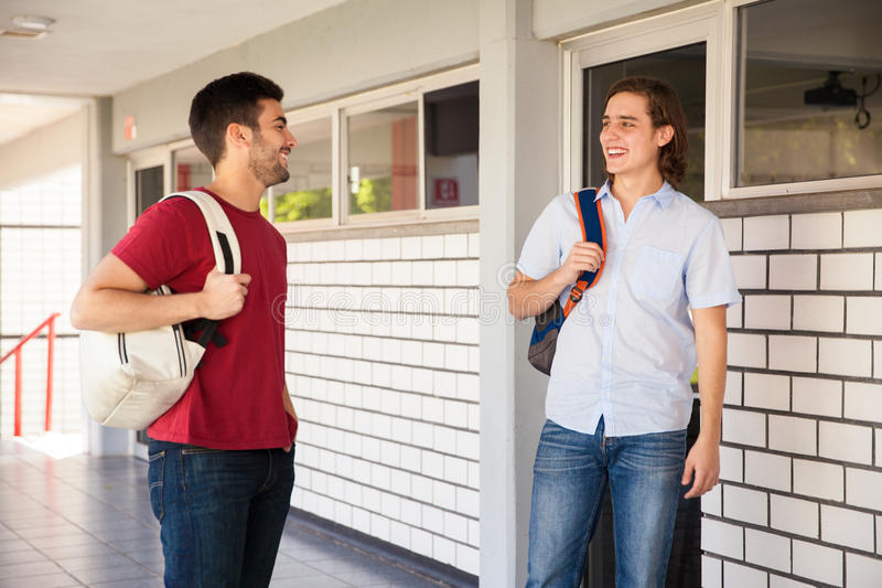 Male friends in college stock image