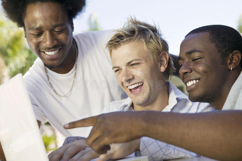 Male Friends Using Laptop royalty free stock images