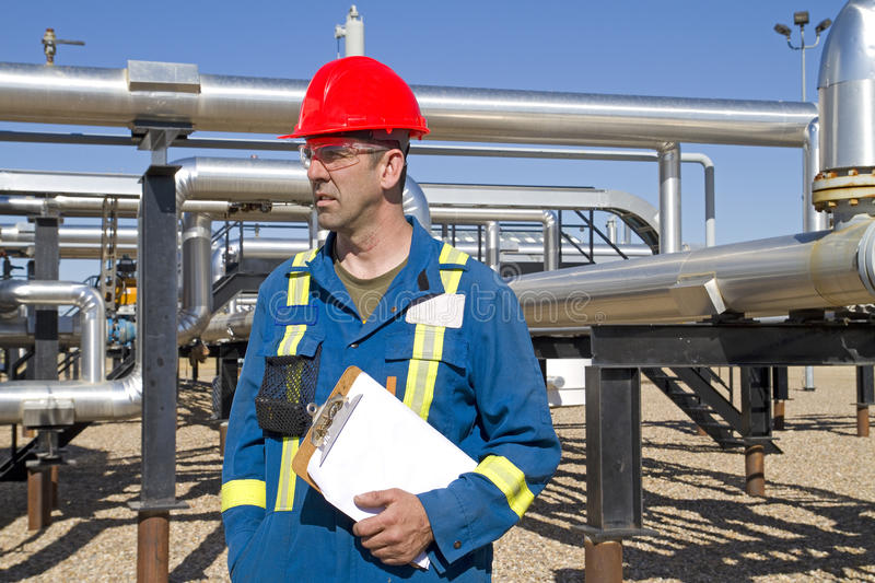 Male gas field operator inspects compressor site stock images