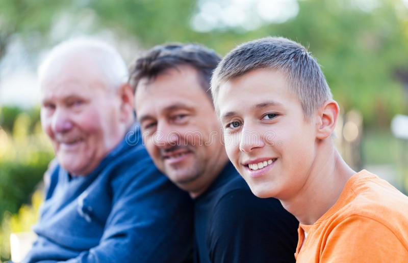 Male generations. Grandfather, son and grandson stock photography