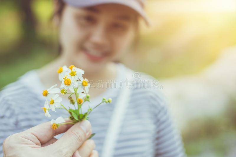 Male giveing flower to lovly girl couple lover outdoor. Park morning green cute royalty free stock images