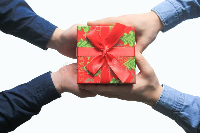 Male gives a christmas gift to male stock photos