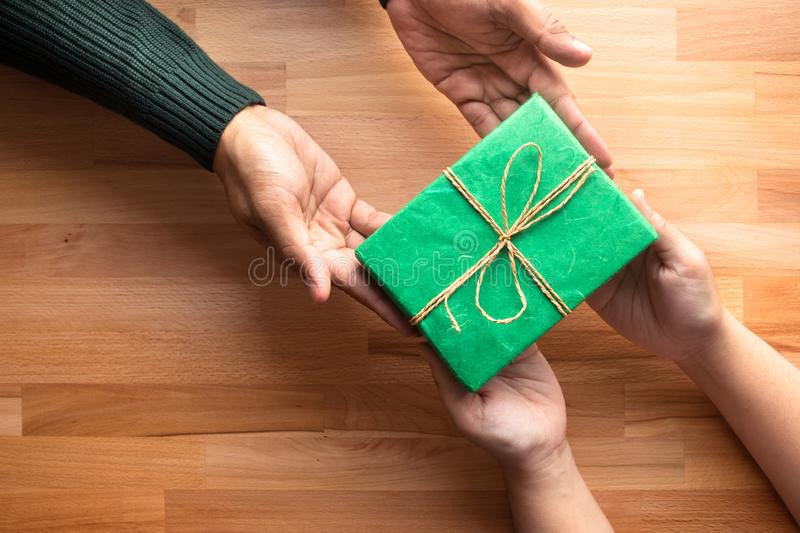 Male gives a gift present to female with wooden copy space. Background.happiness moment concepts ideas stock photos