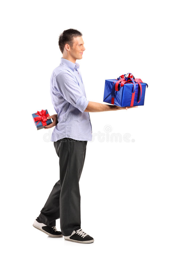 Download Male Giving A Large Gift And Hiding A Small One Stock Image - Image of birthday, length: 20721519