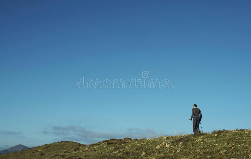 Male going up along hill royalty free stock photos