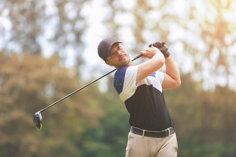 Male golf player on professional golf course. Taking a shot royalty free stock images