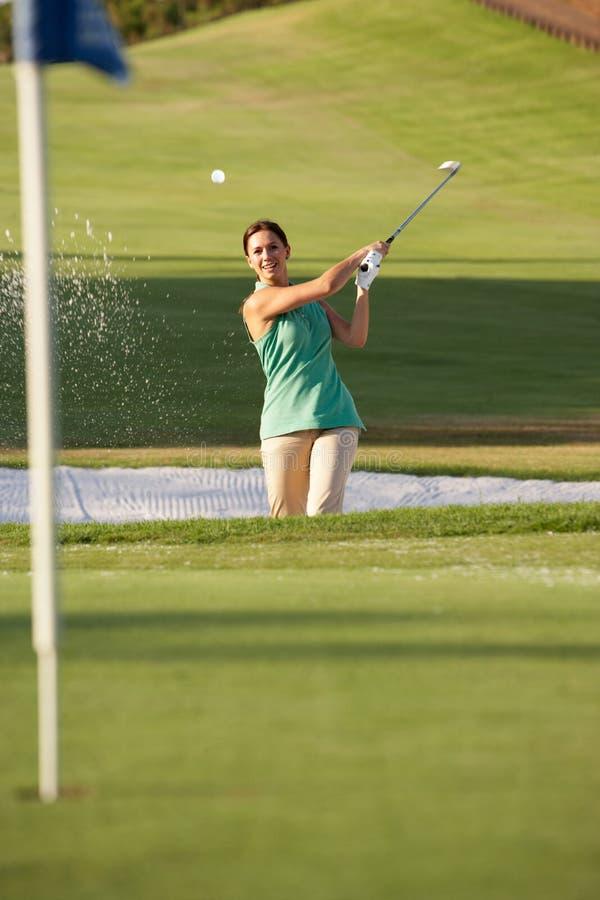 Free Male Golfer Playing Bunker Shot Stock Image - 16304721