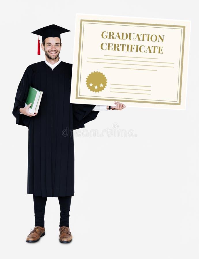Male grad holding a graduation certificate stock image