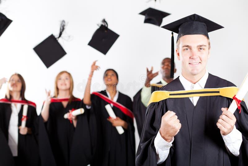 Male graduate at graduation stock photography