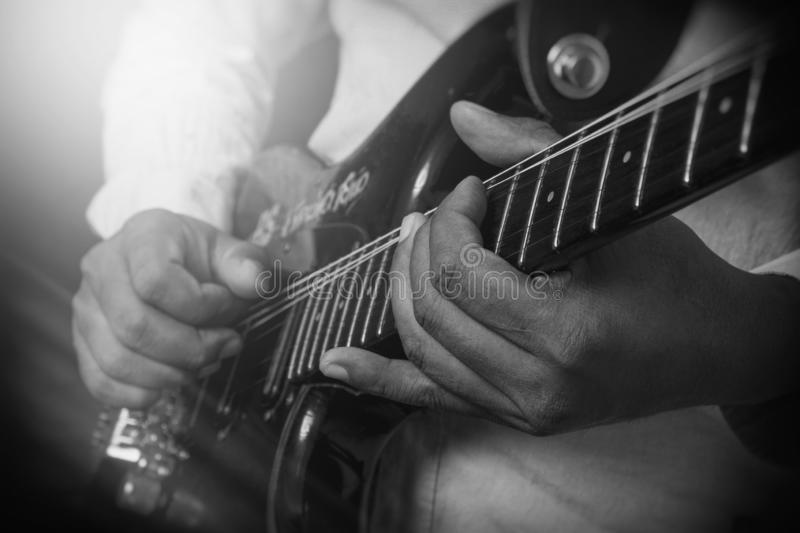 Male Guitar Musician Playing His Electric Guitar royalty free stock photography