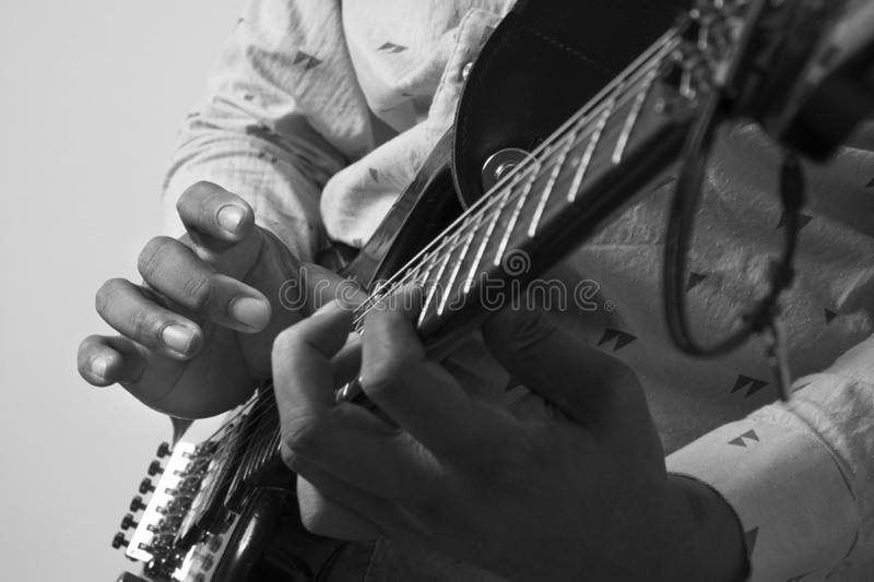 Male Guitar Musician Playing His Electric Guitar stock images