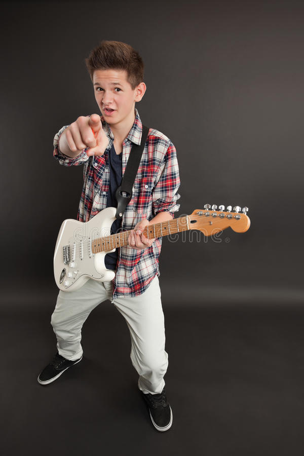 Male With A Guitar Pointing At You Royalty Free Stock Image