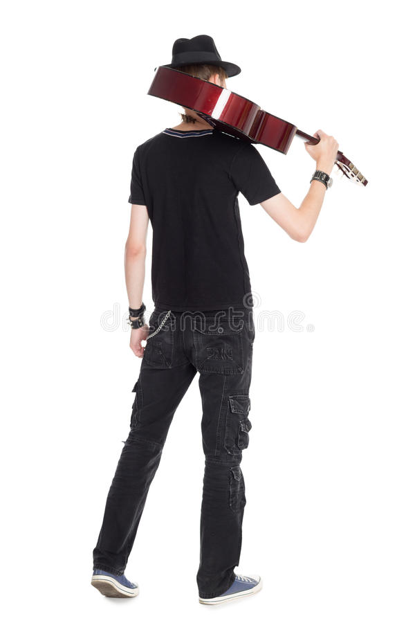Male guitarist with guitar rear view stock photo