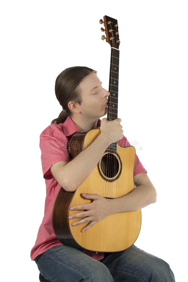 Male guitarist holding his guitar royalty free stock image