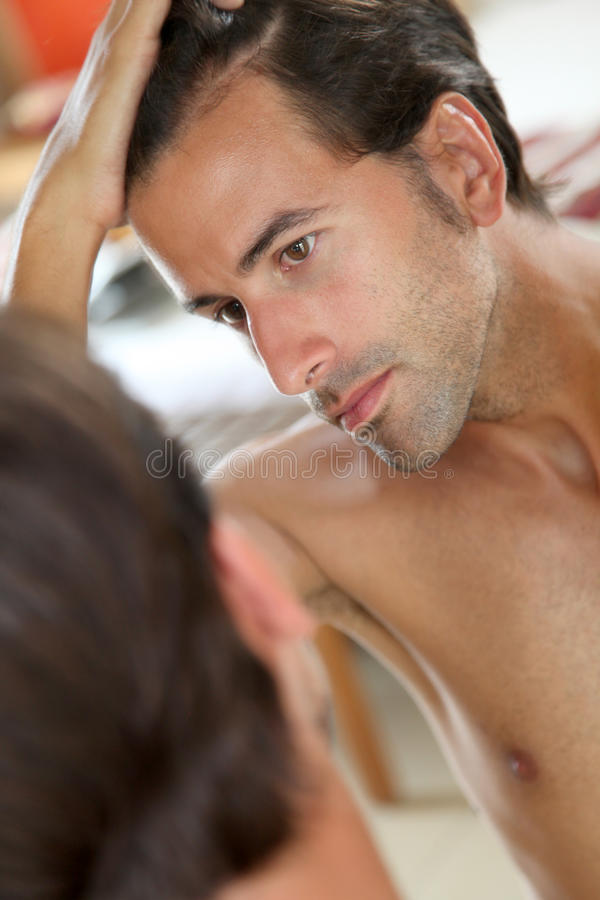 Male hair problem stock photography