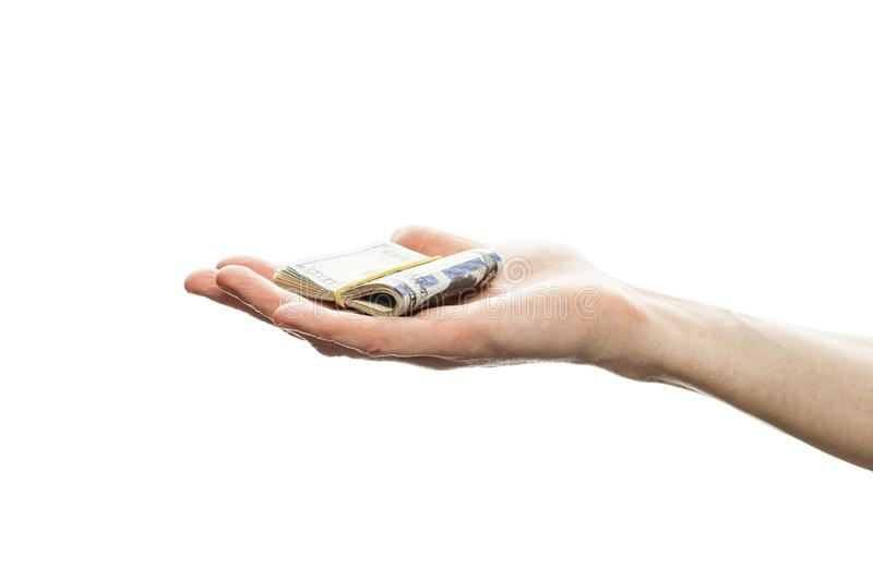 Male hand with american dollars cash money isolated on white background. US Dollars 100 banknote stock photo