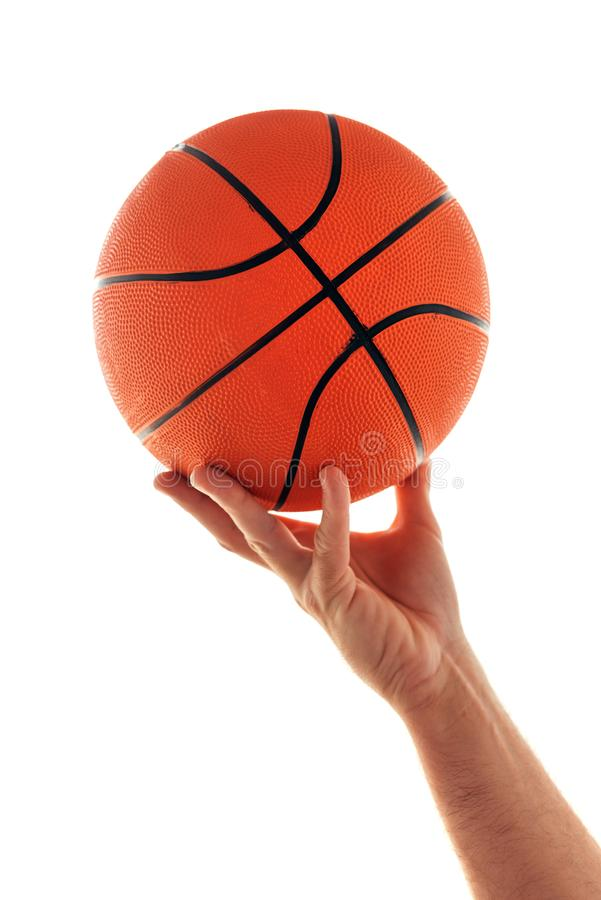 Male hand with basketball ball isolated on white background stock images