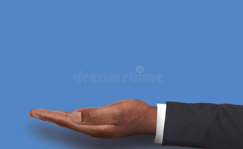 Outstretched male hand over pink background royalty free stock photography
