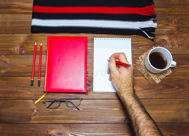Note book and pencil with cup coffee on wooden table royalty free stock images