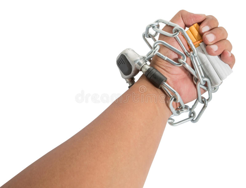 Male Hand, Chains and Cigarette III. Concept image of cigarette addiction enslavement royalty free stock photo