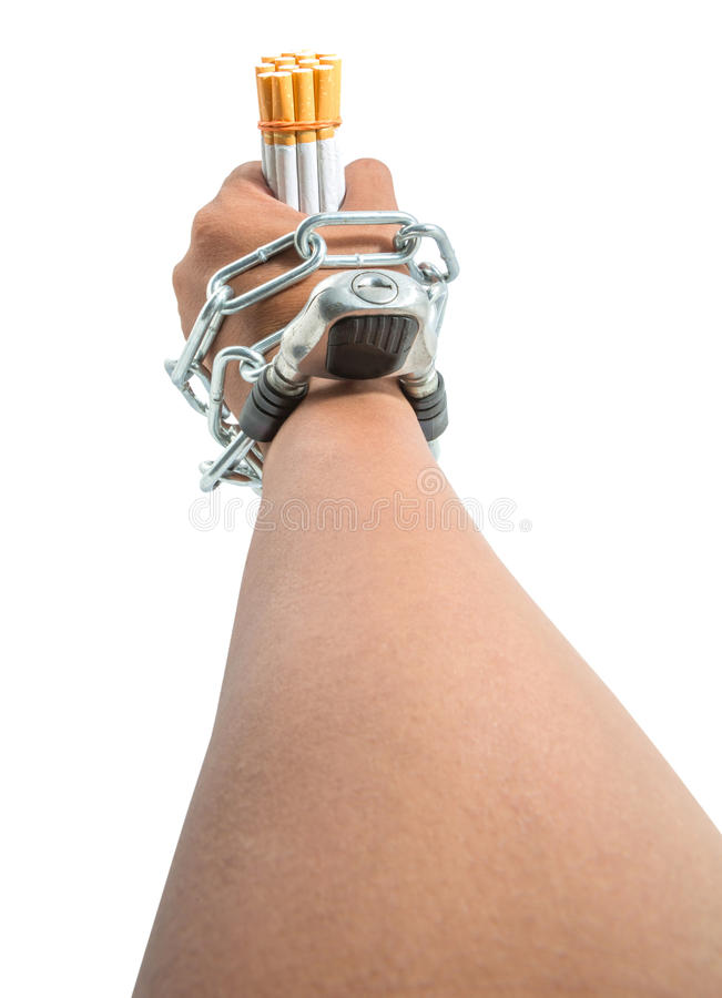 Male Hand, Chains and Cigarette IV. Concept image of cigarette addiction enslavement royalty free stock images