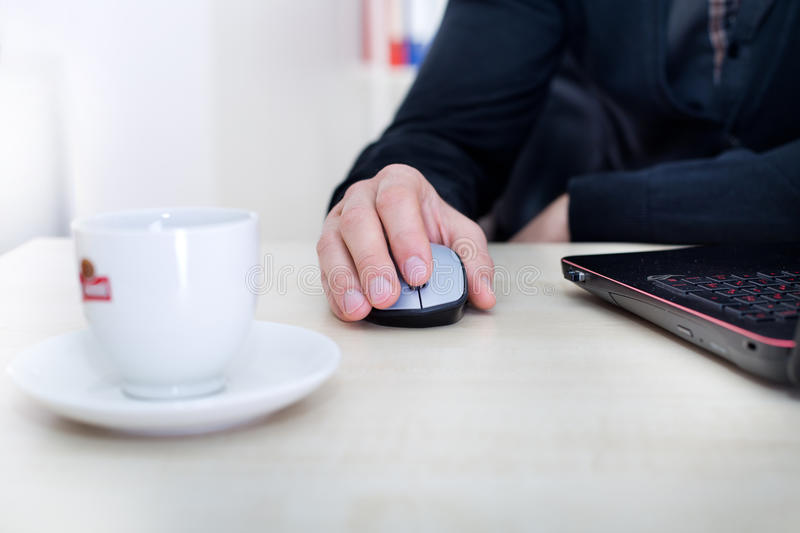 Male hand on computer wireless mouse royalty free stock photography