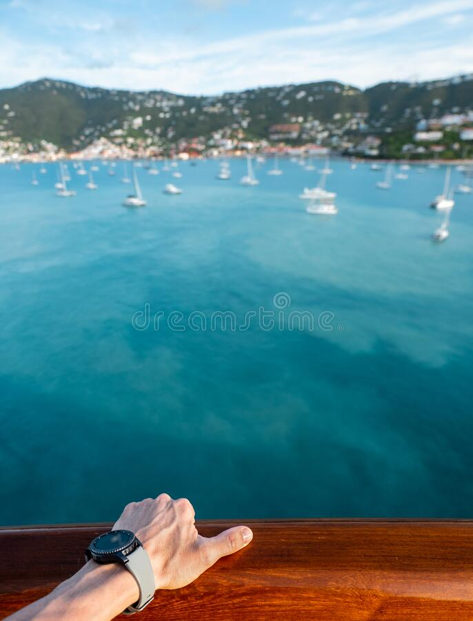 Male hand on deck on a ship stock image