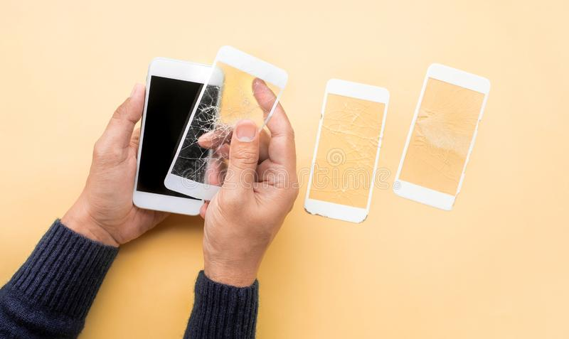 Male hand demonstration changing tempered glass shield or film screen cover with mobile phone.protector concepts. Ideas stock images