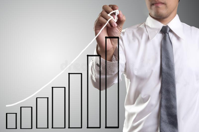 Male hand drawing a chart   stock photography